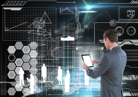 Digital composite of businessman is using tablet taking notes in a futuristic room interface Stock Photo