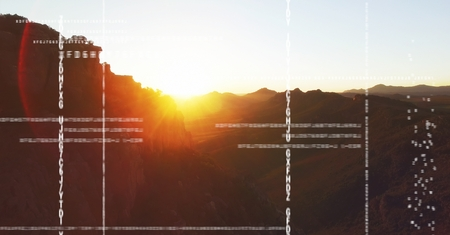 Digital composite of White code against mountain and sunset