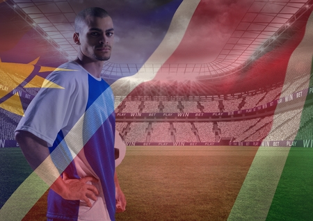 Digital composite of soccer player with the hands on the waist in the field,  superimpose with flag