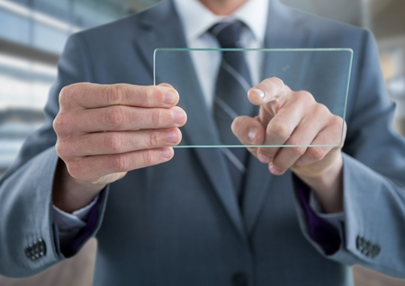 man holding transparent: Digital composite of Businessman holding glass tablet Stock Photo