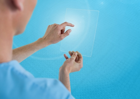 Digital composite of Doctor holding glass tablet and blue background Stock Photo