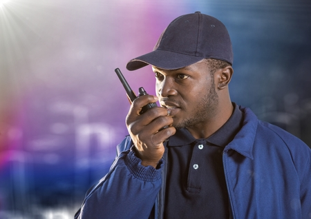 Digital composite of Security guard with walkie talkie against blurry wall with building sketch and flare