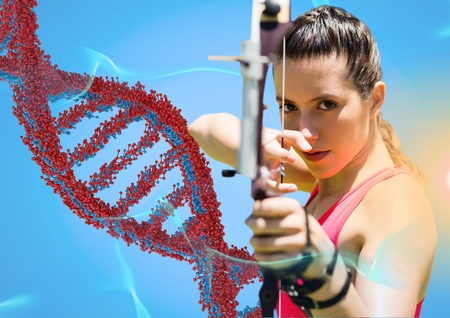 Digital composite of archer woman with red and blue dna chain against blue background and blue and orange lights Stock Photo