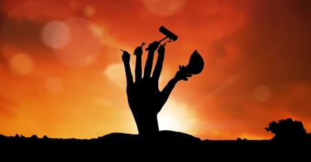 Digital composite of Digital composite image of hand with tools against sky during sunset