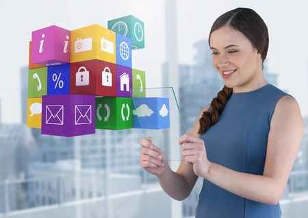 street shot: Digital composite of Businesswoman holding glass screen with apps icons