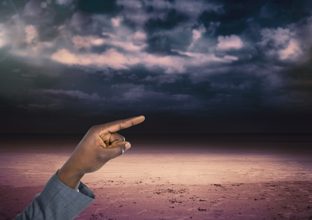 tempest: Digital composite of Hand touching dark cloudy sky
