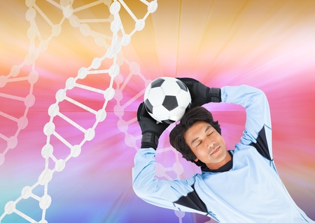 Digital composite of soccer player with white dna chain and colors background