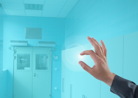 futuristic interior: Digital composite of Hand touching Medical blue background