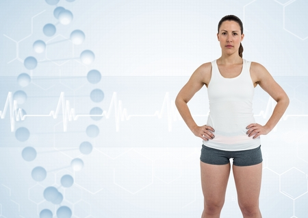 Digital composite of sporty woman with dna chain Stock Photo
