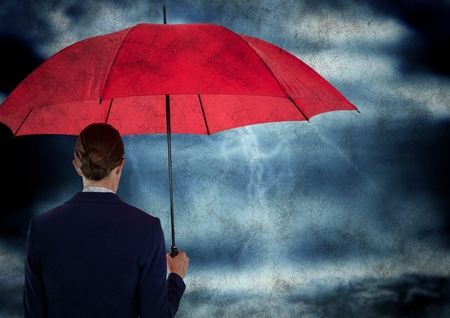 forked: Digital composite of Back of business woman with umbrella in against storm with grunge overlay Stock Photo
