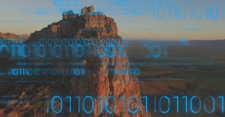 Digital composite of Blue binary code against cliff