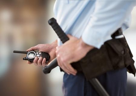 Digital composite of security guard with walkie-talkie. blurred back Standard-Bild