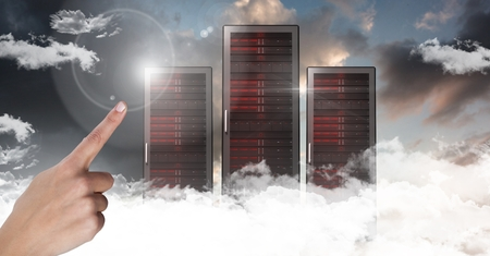 Digital composite of Hand touching air with servers in clouds and sky background