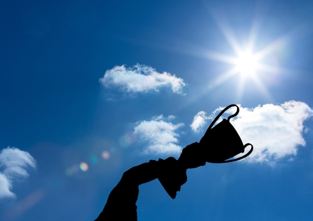 Digital composite of business hand  with trophy shade in the sky