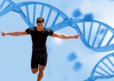 Digital composite of runner with blue dna chain background Stock Photo