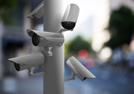 Digital composite of a focus on CCTV group in a blurred and light street Stock Photo