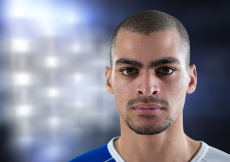 Digital composite of foreground of a soccer player with lights background
