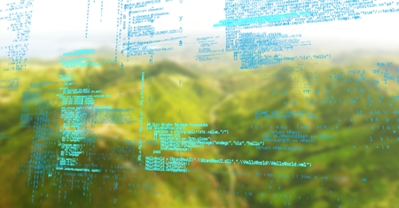 Digital composite of Blue code against green blurry mountains