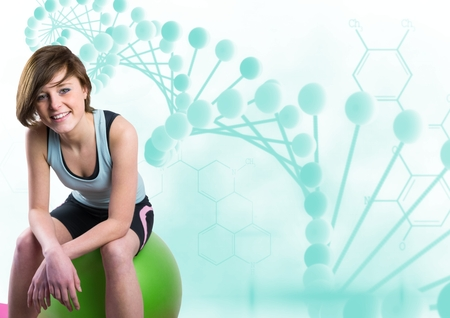 computer science class: Digital composite of sporty woman sitting on a ball with blue dna chain Stock Photo