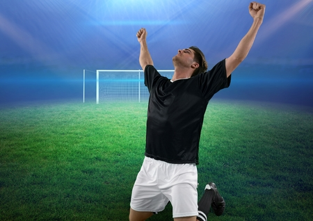 jersey: Digital composite of soccer player on knees celebrating a goal Stock Photo