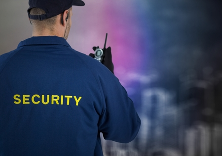 Digital composite of Back of security guard with walkie talkie against blurry wall with building sketch