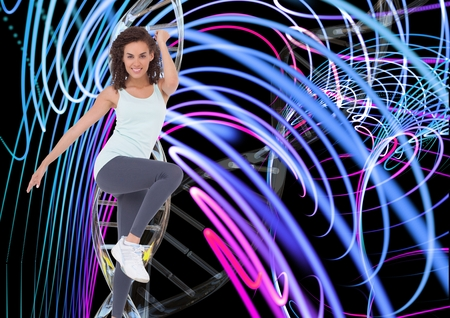 Digital composite of aerobic woman with dna chain and lights Stock Photo