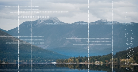 Digital composite of White code against mountain and water