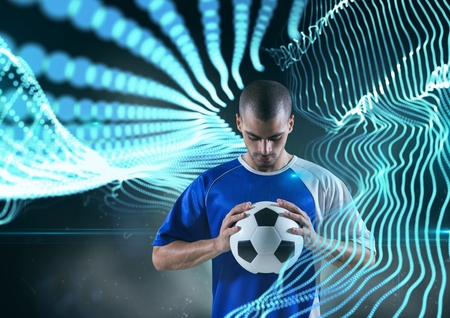 Digital composite of soccer player with ball with blue lights