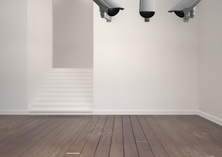 Digital composite of 3 CCTV in the wall in an empty room Stock Photo