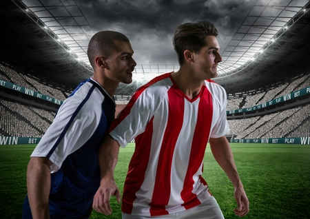 plating: Digital composite of footballer playing a soccer match Stock Photo