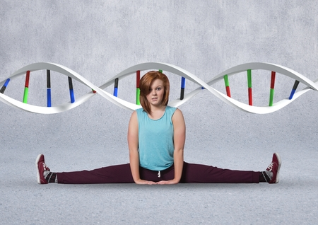 Digital composite of sporty woman with colors dna chain Stock Photo