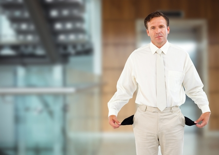 Digital composite of sad man with white suit and with empty pockets in front of the elevator