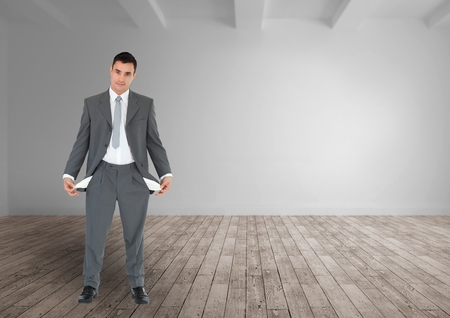 Digital composite of empty pocket businessman in a empty room Stock Photo