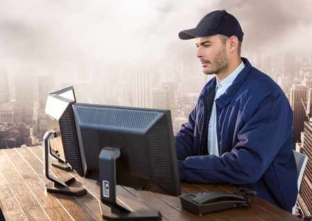 Digital composite of Security man on computer over large city Stock Photo