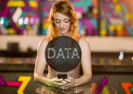 Digital composite of Data text in circle against woman with phone in club Stock Photo
