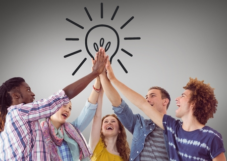 comfort classroom: Digital composite of Trendy team putting hands together against lightbulb graphic and grey background