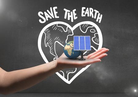 Composito digitale di pannello solare e terra a portata di mano. Priorità bassa nera della parete con i graffiti della terra di risparmi