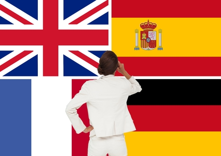Digital composite of main language flags around woman with the back facing Stock Photo