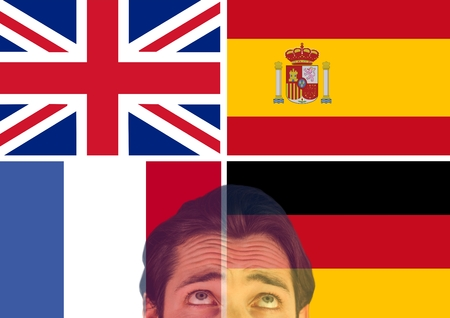 Digital composite of main language flags and foreground of man looking up, overlap