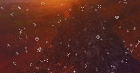 Digital composite of White network against mountain rock in sunset