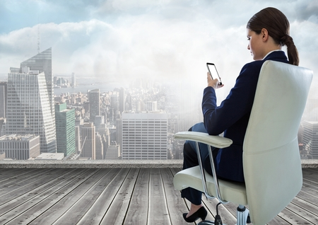 flooring: Digital composite of Businesswoman Back Sitting in Chair with mobile phone over city Stock Photo