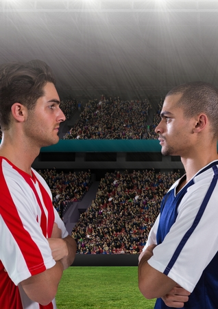 competitors: Digital composite of soccer players in the field with their fans behind them, looking each other.
