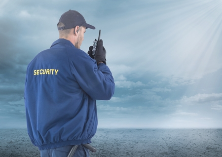 Digital composite of Security man outside with clouds Stock Photo