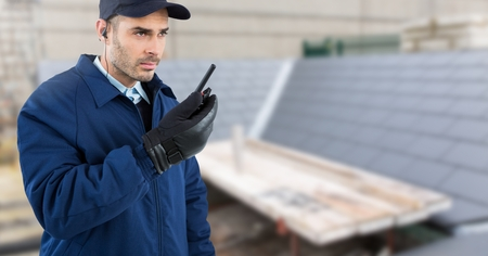 Digital composite of Security man on rooftop building site
