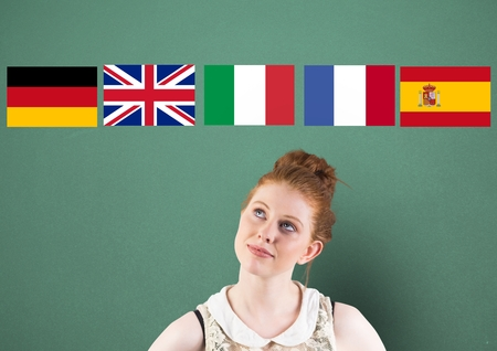 inquiring: Digital composite of main language flags over young woman thinking. Green background