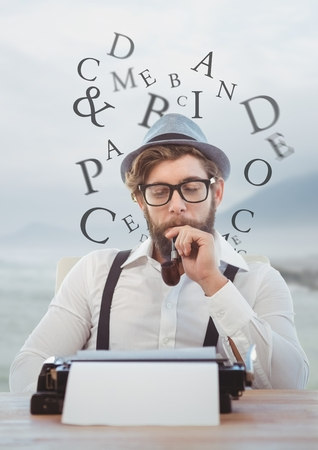 Digital composite of Hipster man  on typewriter with letters and blue mountain landscape Stock Photo