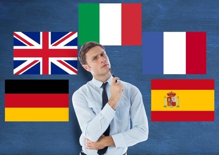 floorboards: Digital composite of main language flags around young man. Dark blue background
