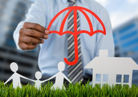 insurer: Digital composite of Holding umbrella over insurance cut outs home family with buildings