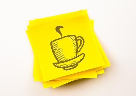 Digital composite of Brown coffee graphic against yellow sticky note Stock Photo