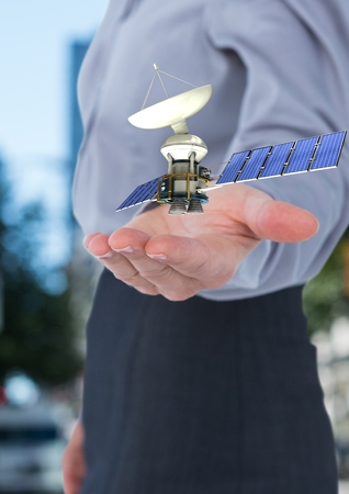 Digital composite of satellite solar panel on hand of a businesswoman in the city